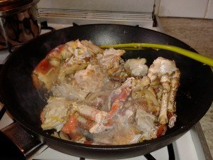The crab cooking in the wok before adding in the sauce.