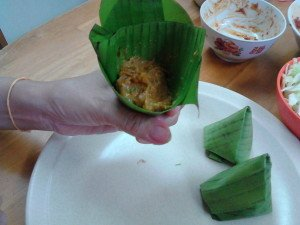The cone fashioned from banana leaves, with some of the paste