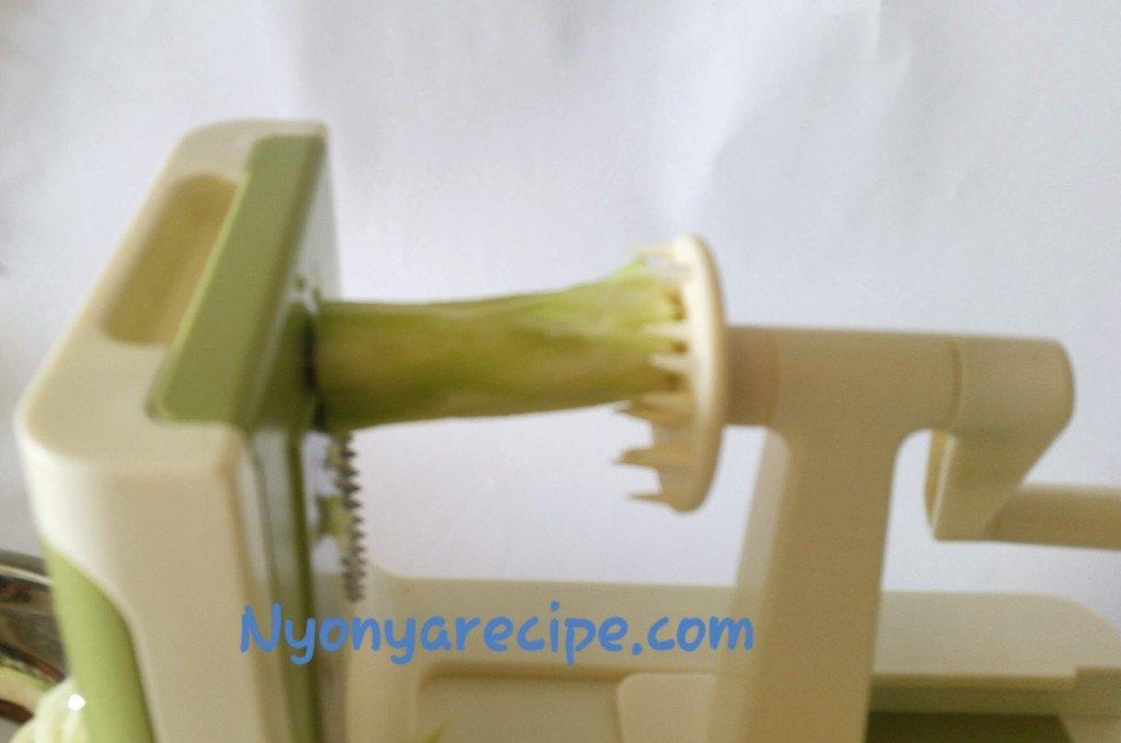 Broccoli stem in the spiralizer.