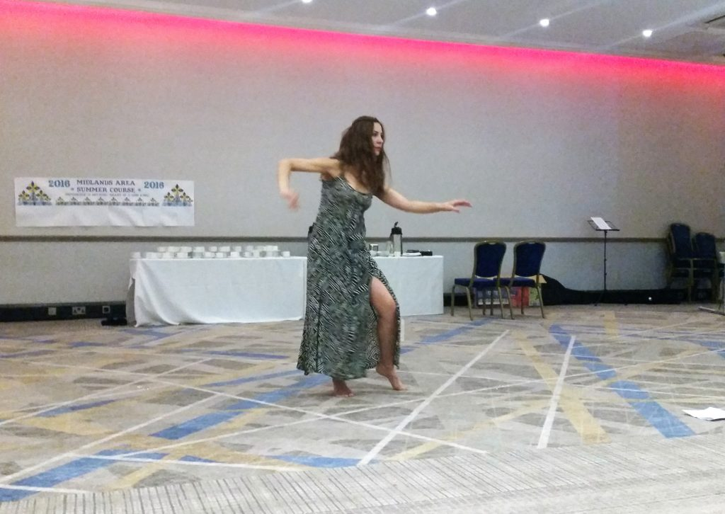 Our very own dancer. Meral is a very talented dancer and had performed many times. I remember she did the Middle-eastern dance the previous year and a belly dance last year, I was told. She has such grace and one can feel that she is actually feeling the groove...