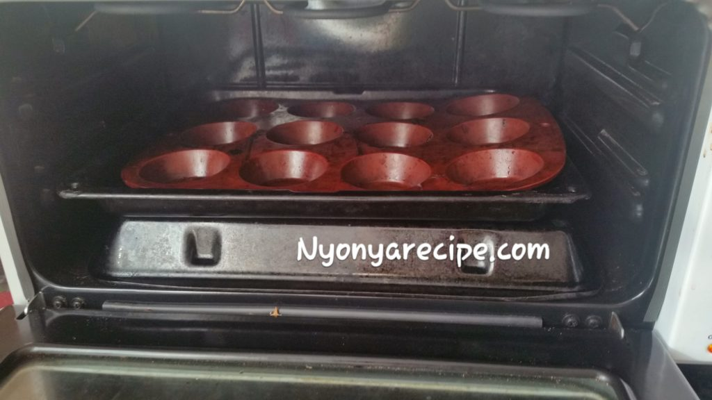 The muffin tin in an oven toaster. The oil is beginning to smoke.