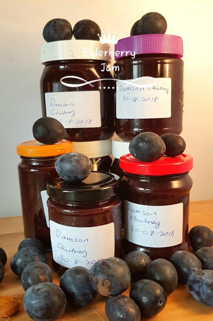 Jars of Damson chutney with damson fruits.