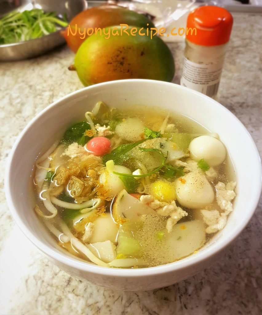 A bowl of savoury Tang Yuan with beansprouts, chicken, vegetables and seasoning.