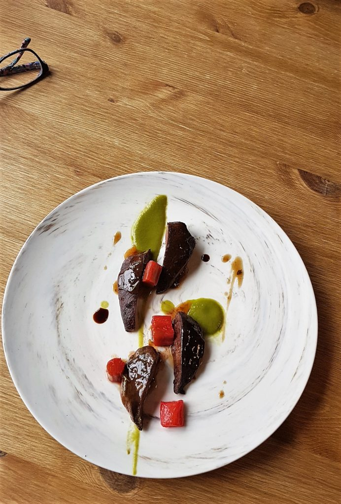 Pieces of pigeon breast basted in balsamic, bean puree, rhubarb.