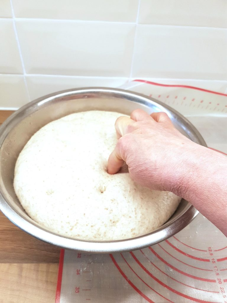 Fridge dough being tested by pricking with a finger.