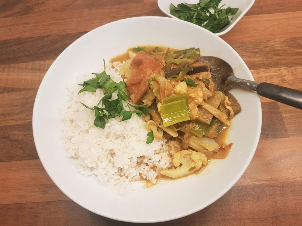 Vegetable curry served with white rice.